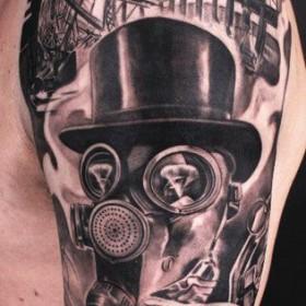 Фото крутого тату в стиле стимпанк на рукаве парня