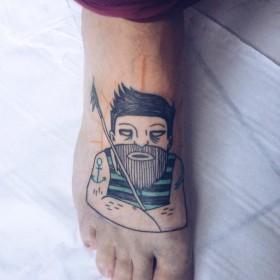Фото тату в стиле ар брют на ступне парня