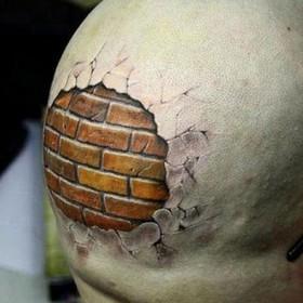 Кирпичная стена в стиле 3д - татуировка на голове парня