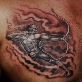 Тату на груди парня - знак зодиака стрелец
