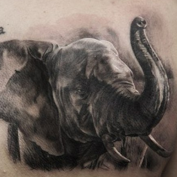 что означает наколка слон на пальцах