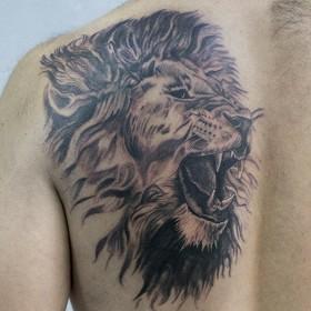 Фото татуировок на плече львы 29