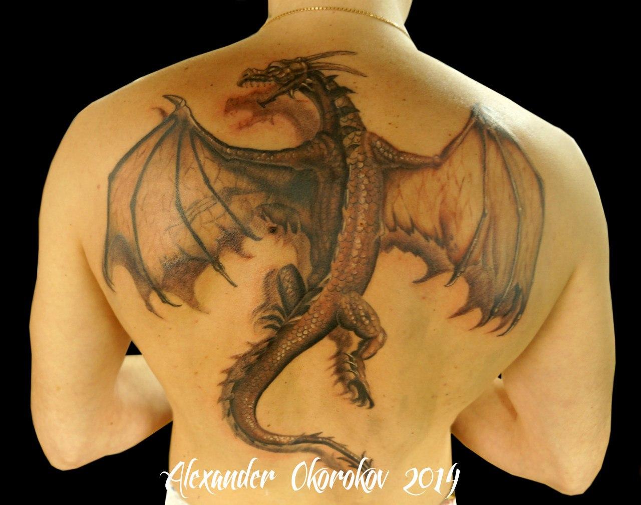 Татуировка дракон на спине фото