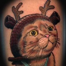 Тату на плече девушки - кошка