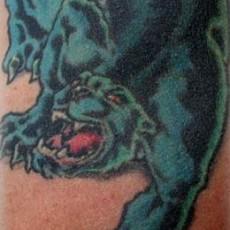 Пантера на ребрах тату