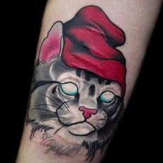 Татуировка на женском предплечье - кот